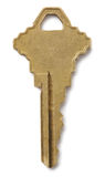 Brass key. Isolated against a white background royalty free stock image
