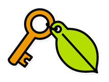 Brass key with a green environment leaf tag Stock Photos