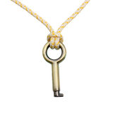 A Brass key hanging by a thread Royalty Free Stock Photos