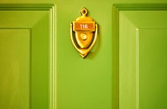 Brass Knocker Green Door Stock Photo