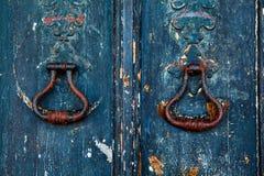 Brass knocker on old wooden door. In Lisbon stock image