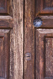 Brass  knocker and wood  glass door caronno varesino varese Stock Photos