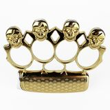 Brass knuckle duster, weapon for hand, isolated on white. Design, gangster. Brass knuckle duster with golden skull, weapon for hand, isolated on white background royalty free stock photography