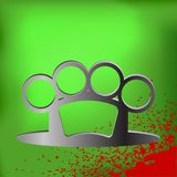 Brass Knuckle. Metal Brass Knuckle and Drops of Blood on Green Background Royalty Free Stock Photography