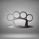 Brass Knuckle. Metal Brass Knuckle on Grey Light Background Stock Photos