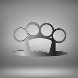 Brass Knuckle. Metal Brass Knuckle on Grey Light Background Stock Photo