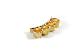 Brass Knuckles. A pair of brass knuckles on a white background Royalty Free Stock Images