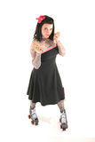 Brass knuckles. Rollergirl standing isolated on white with brass knuckles Stock Photography