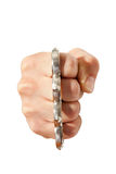 Brass knuckles on fist Royalty Free Stock Photography