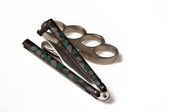 Brass knuckles and knife Stock Image