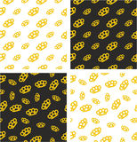 Brass Knuckles or Knuckle Duster Big & Small Aligned & Random Seamless Pattern Gold Color Set Stock Images