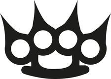 Brass knuckles with spikes. Vector Stock Photography