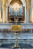 Brass Lectern with blurred Organ in Wells Cathedral. England, Wells - 02 Sep 2016: Brass Lectern with blurred Organ in Wells Cathedral Shallow Depth of Field Royalty Free Stock Image