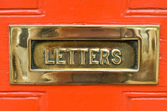 Brass Letter Box. A brass Letterbox taken from a door in an English Town royalty free stock photo
