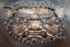 Brass lion head sculpture in thai temple. The brass lion head sculpture in thai temple stock photography
