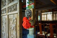 Brass lion-shaped door knocker on glass Stock Photos