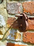 Locked and Walled. Brass lock embedded in an ancient Roman brick wall at the Bishop Palace Garden in Chichester, England, UK royalty free stock photos