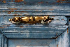 Brass lock. On an old blue door stock photo