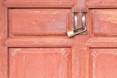 Brass lock on Old Red Wood Doors. Close up of Brass Padlock on Old Red Wood Doors (focus on lock&#x29 Stock Photography