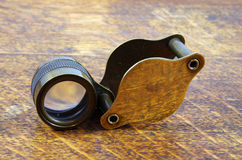 Brass Loupe on Oak Table Stock Images