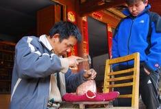 Brass making in China Stock Photo