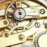 Brass mechanical clockwork of retro watch Stock Photography