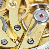 Brass mechanical movement of retro clock Stock Photo