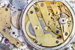 Brass mechanical watch on pile of spare parts Stock Photo