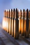 Brass metal bullet cartridge close-up  gauge caliber. Brass metal bullet cartridge close-up 7.62 gauge caliber Royalty Free Stock Photo