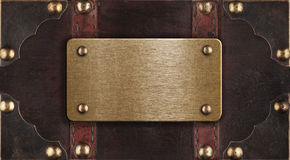 Brass metal plate on chest cover Stock Photos