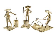 Brass model of Thai merchant farmer and fisherman Stock Photos