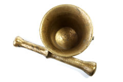 Brass mortar with a pestle isolated on a white Royalty Free Stock Image