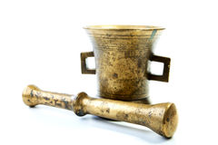 Brass mortar with pestle  on a white Royalty Free Stock Images