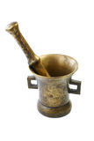 Brass mortar with a pestle  on a white background Stock Photos