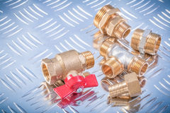 Brass nipple hose connectors equal tee check water valve on groo. Ved metal background plumbing concept Stock Image
