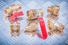Brass nipple hose connectors equal tee check water valves on cha Stock Photos