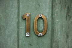 Brass number ten on door Royalty Free Stock Photo