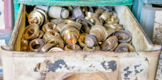 Brass nuts in drawer Stock Photo