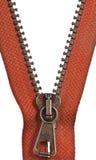 Brass orange zip fastener close up Stock Photos