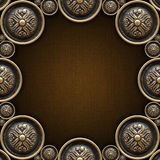 Brass Ornaments on Brown Canvas Royalty Free Stock Image