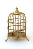 Brass ornate birdcage with locked shut door. Stock Images