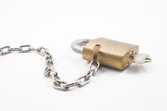 Brass padlock. A heavy duty industrial brass padlock with key Royalty Free Stock Images