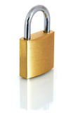 Brass Padlock. A brass padlock, reflected on a white surface royalty free stock image