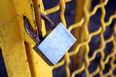 Brass padlock. And chain on yellow cell door stock photos