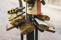 Brass Padlock on Black Metal Stand Stock Image