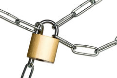 Brass padlock connecting multiple chains over white background Royalty Free Stock Image