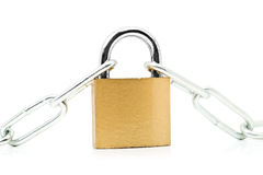 Brass padlock connecting two chains over white background Royalty Free Stock Photography