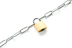 Brass padlock connecting two chains over white background Royalty Free Stock Images