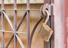 Brass padlock hook on door loop - unlocked Stock Photography