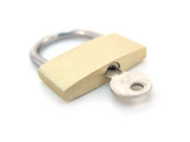 Brass padlock with key - locked Royalty Free Stock Images